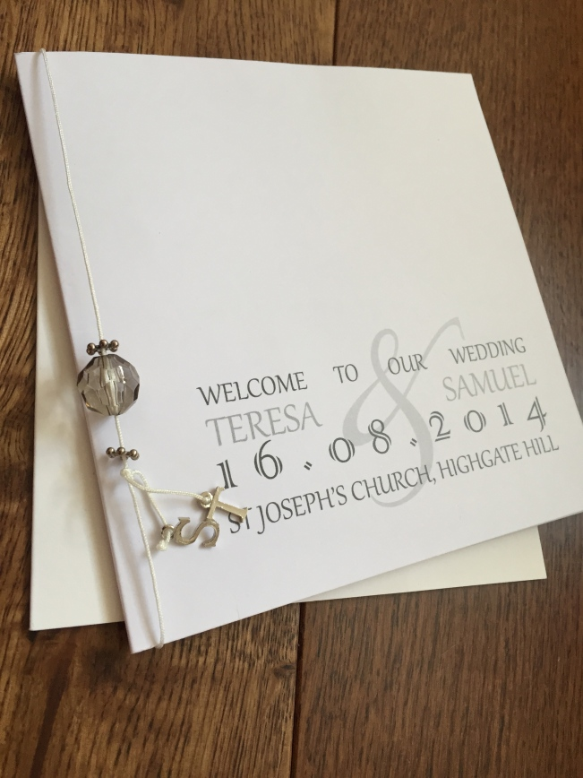 Order of service - designed and made by bride. The beaded S and T charmed spacer adds an additional personal touch to the day